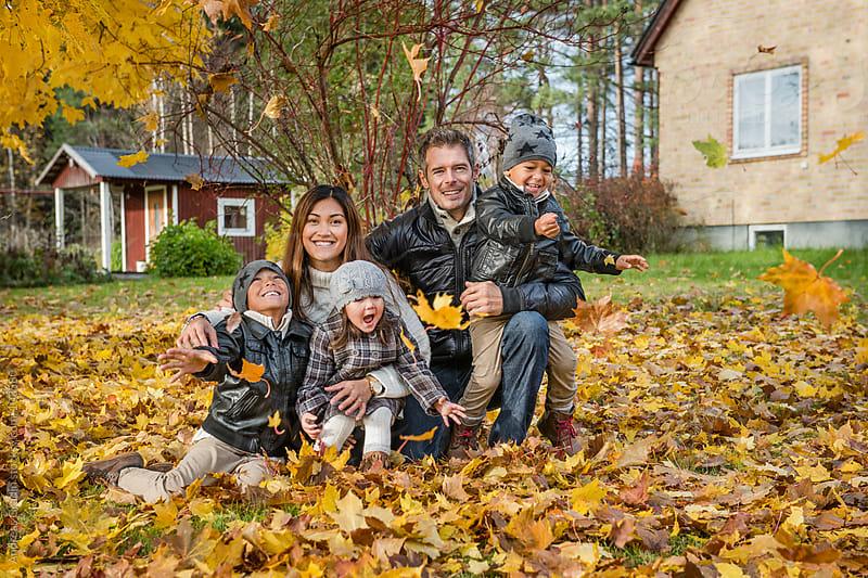 happy autumn family by Andreas Gradin for Stocksy United