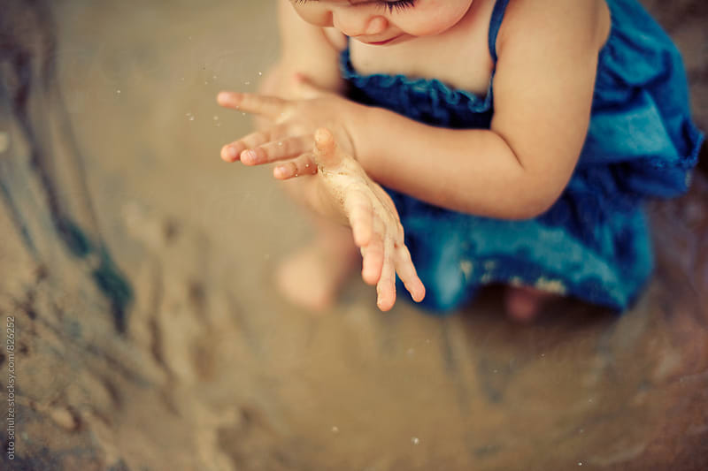 Baby's sandy hands by otto schulze for Stocksy United