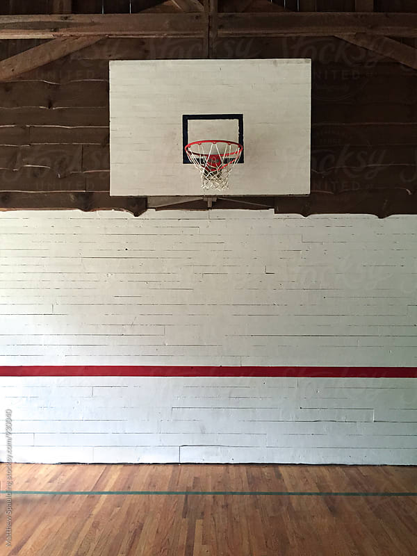Basketball hoop in wood gym by Matthew Spaulding for Stocksy United