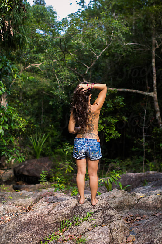 Young Woman Standing in the Jungle by Mosuno for Stocksy United