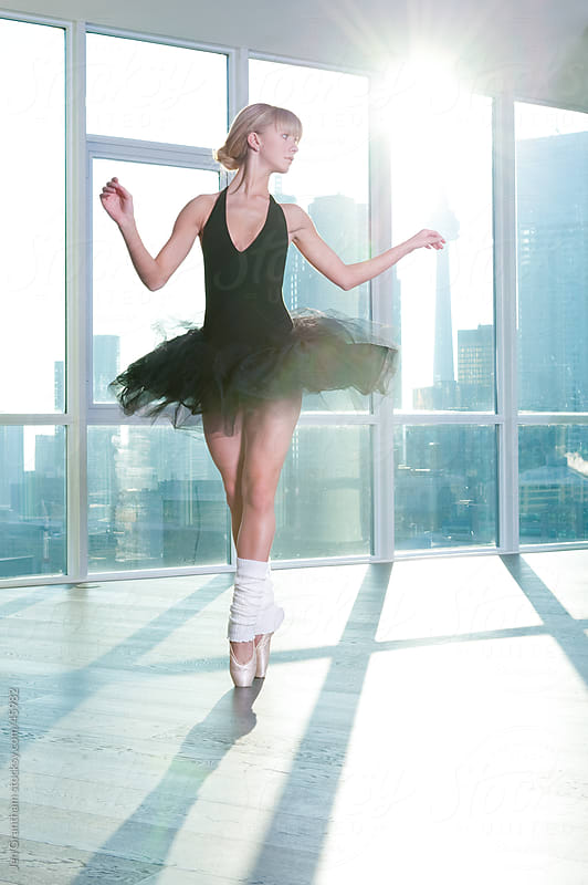 Ballerina dancing with city in background by Jen Grantham for Stocksy United