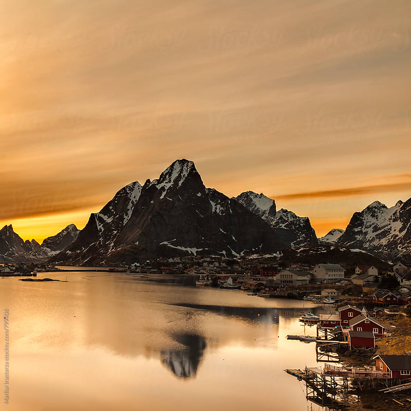 Midnight sun shines over the beautiful fishing village of Reine by Marilar Irastorza for Stocksy United