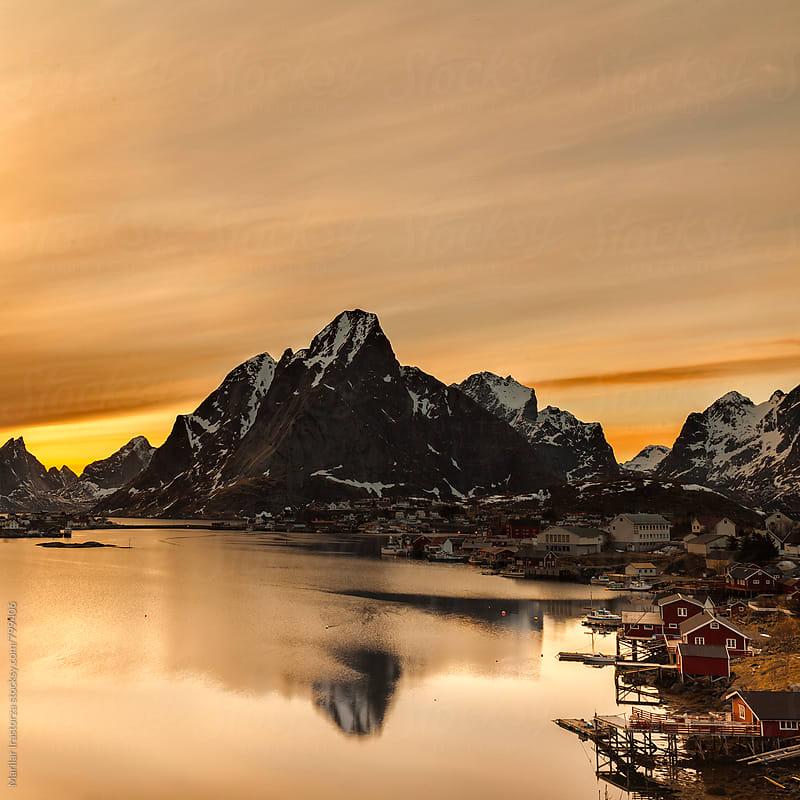 Midnight sun shines over the beautiful fishing village of Reine by Marilar Irastorza for Stocksy United