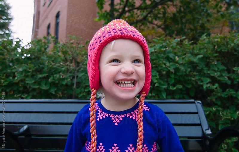 happy little girl in ski hat by Margaret Vincent for Stocksy United