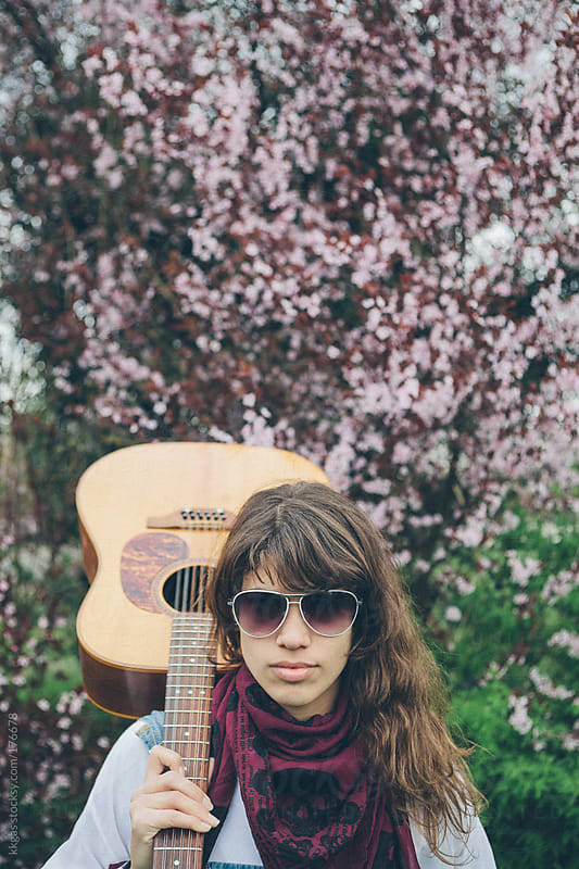Young woman with guitar outdoors  by kkgas for Stocksy United