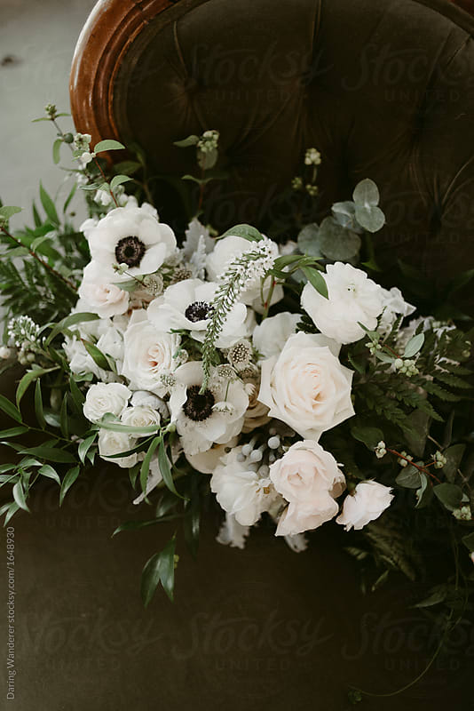 Simple white and green wedding bouquet with vines and white flowers simple white and green wedding bouquet with vines and white flowers by daring wanderer for stocksy mightylinksfo