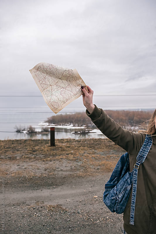 Unrecognizable female traveler holding travel map by Danil Nevsky for Stocksy United