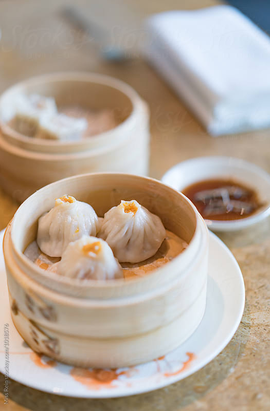 Dumplings, Chinese traditional cuisine specialties by Miss Rein for Stocksy United