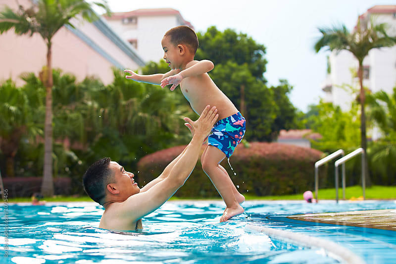 happy father with his son in the swimming pool by Bo Bo for Stocksy United
