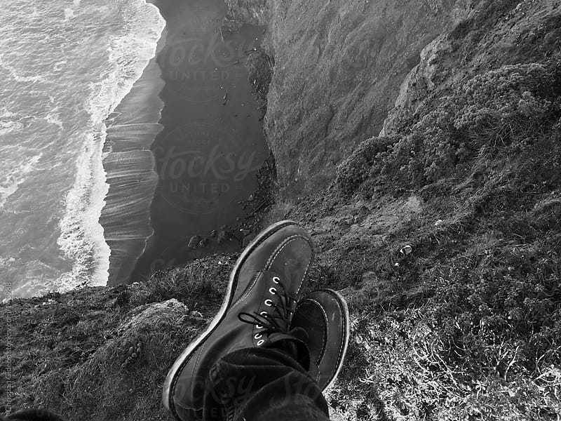 Sitting on Ocean Cliffs by Christian Gideon for Stocksy United