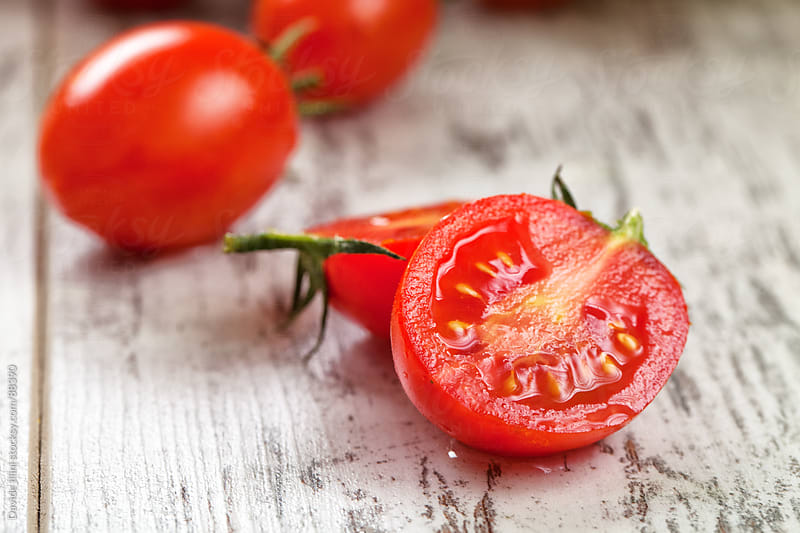 Fresh Red Cherry Tomatoes by Davide Illini for Stocksy United