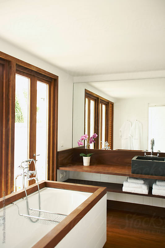 Modern design bathroom in luxury hotel room by Trinette Reed for Stocksy United