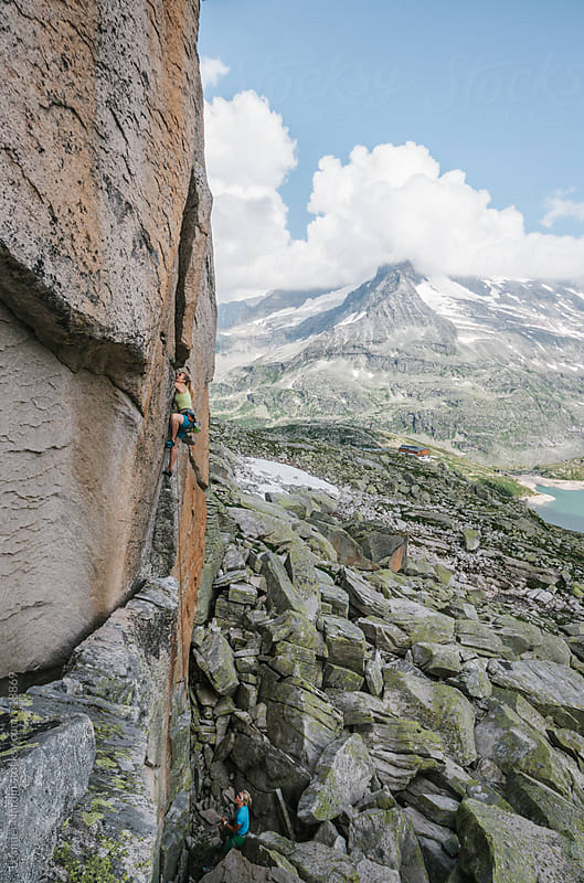 two female rock climber in alpine mountain scenery by Leander Nardin for Stocksy United