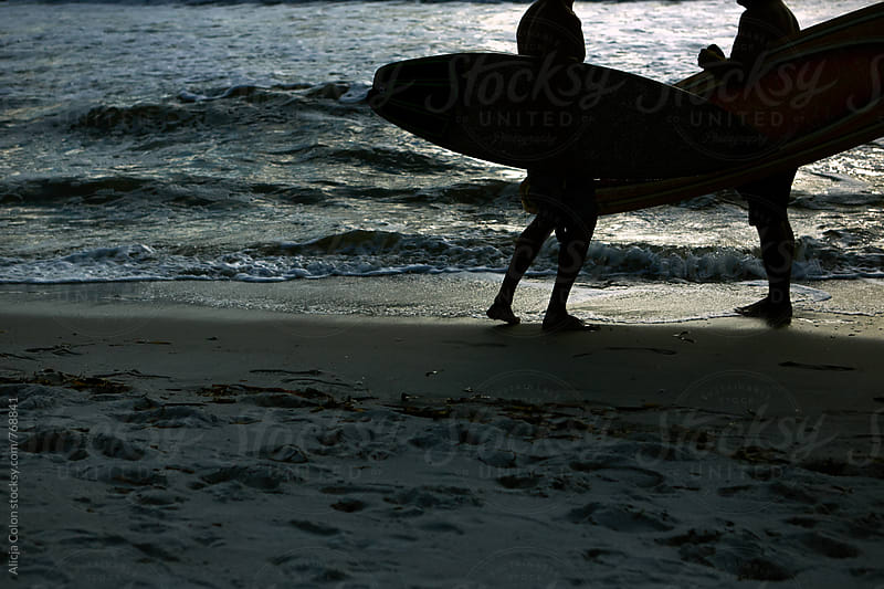 Surfer conversation at sunset by Alicja Colon for Stocksy United