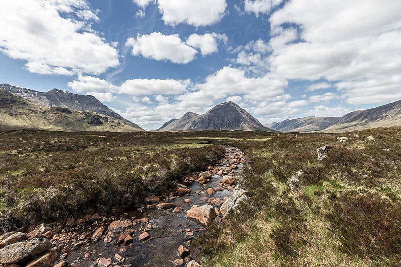 River floats through scottish highlands by Leander Nardin for Stocksy United