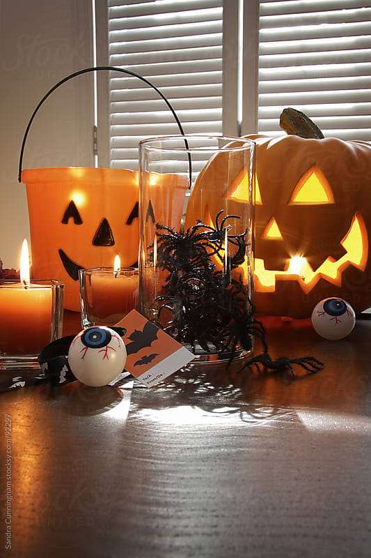Pumpkin, candles and spiders in a jar for Halloween by Sandra Cunningham for Stocksy United