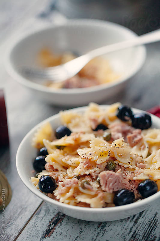 Pasta with tuna, black olives and capers by Davide Illini for Stocksy United