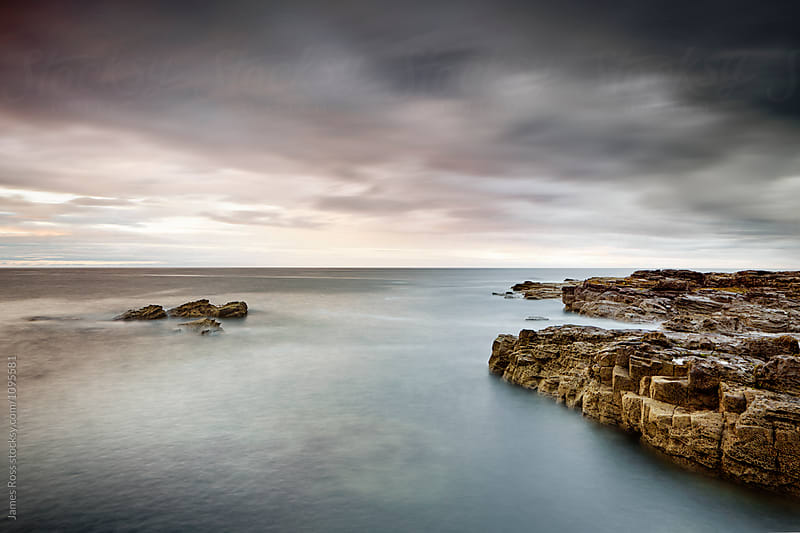 Rocks at high tide by James Ross for Stocksy United