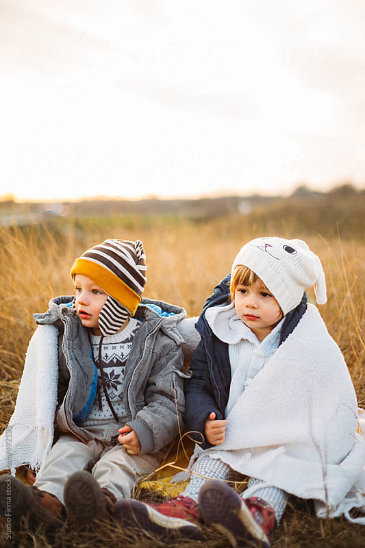 Kids in the park covered with white blanket. by Studio Firma for Stocksy United