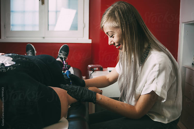 Tattoo artist at work by Giada Canu for Stocksy United