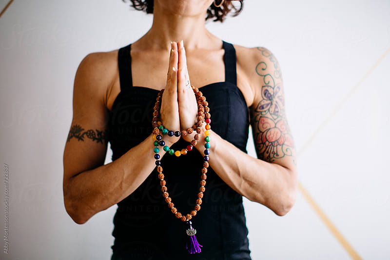 Woman with Yoga Mala Beads by Abby Mortenson for Stocksy United