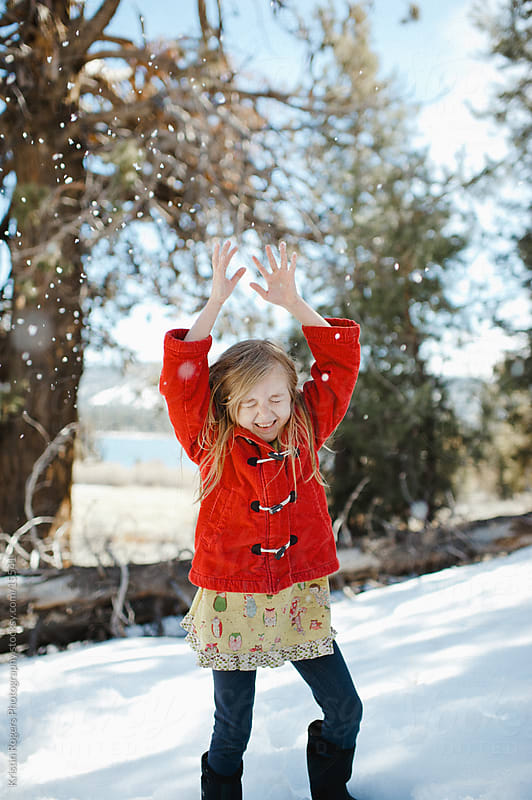 Playing in Snow by Kristin Rogers Photography for Stocksy United