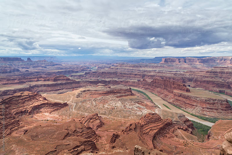 Looking down at the Colorado River and vast canyons by Adam Nixon for Stocksy United