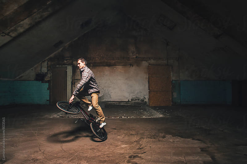 Man Performing Tricks on His BMX Bike by Lumina for Stocksy United
