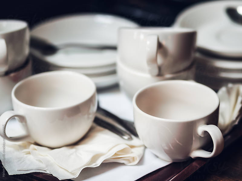 Cups and saucers after the coffee break by Helen Sotiriadis for Stocksy United