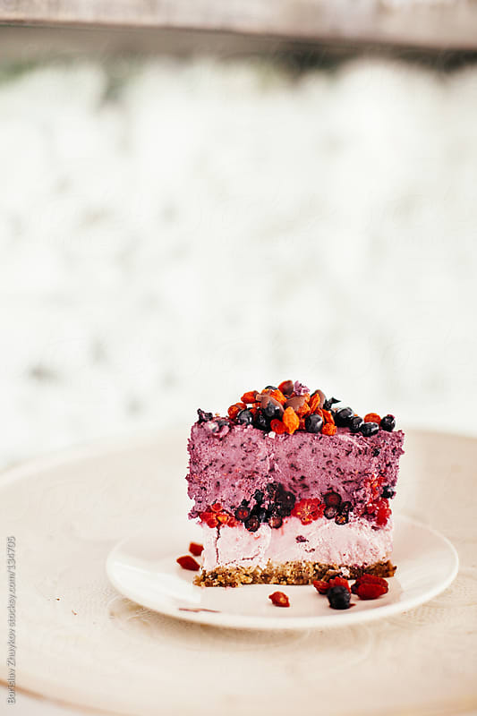 Piece of healthy raw vegetarian cake by Borislav Zhuykov for Stocksy United