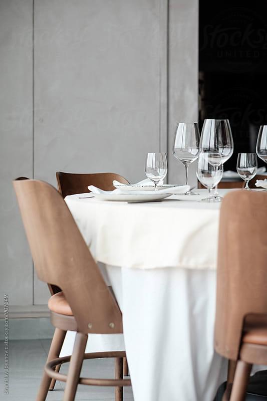 Empty Table at the Restaurant by Branislav Jovanović for Stocksy United