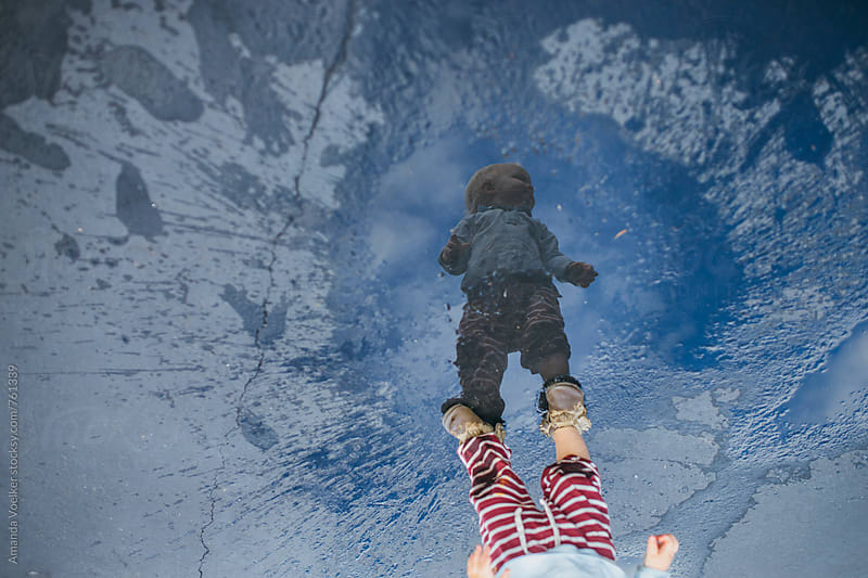 Puddle Portrait of A Toddler Boy by Amanda Voelker for Stocksy United