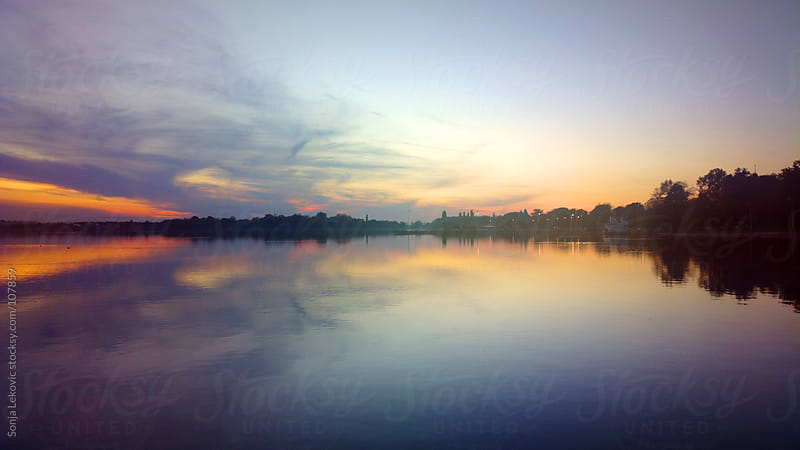 sunset on the lake landscape by Sonja Lekovic for Stocksy United