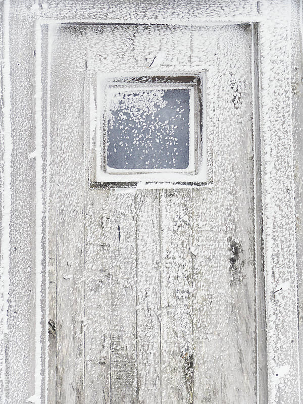 Frost and snow on an exterior door by rolfo for Stocksy United