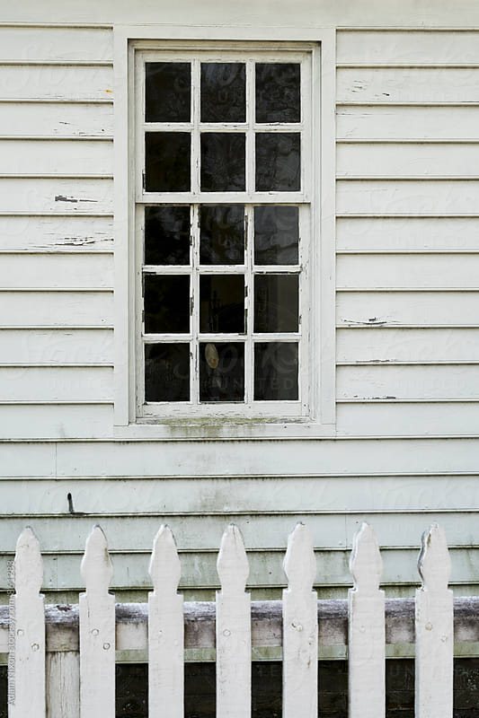 Old weathered white picket fence and window by Adam Nixon for Stocksy United