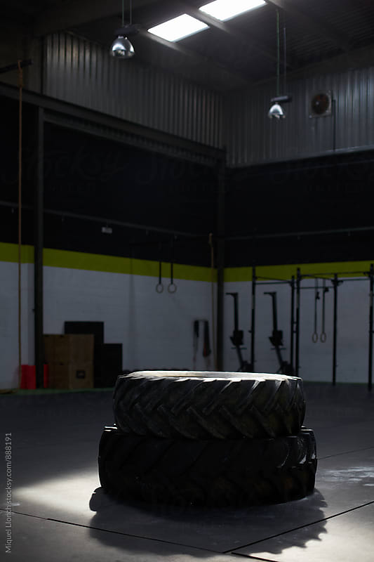 Gym space with two big tires for fitness workout by Miquel Llonch for Stocksy United