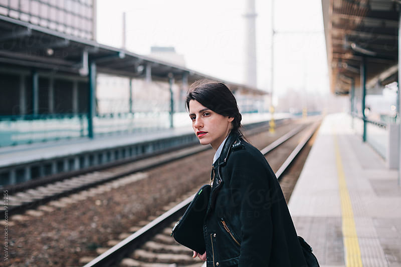 Beautiful woman waiting for a train by VeaVea for Stocksy United