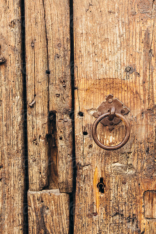 Rusty Ring on a Wooden Old Door