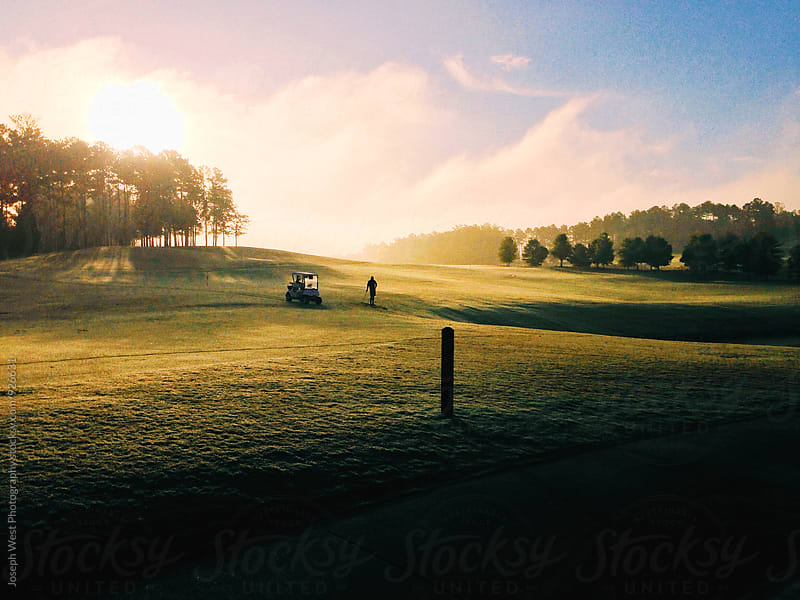 Golfing at sunrise by Joseph West Photography for Stocksy United