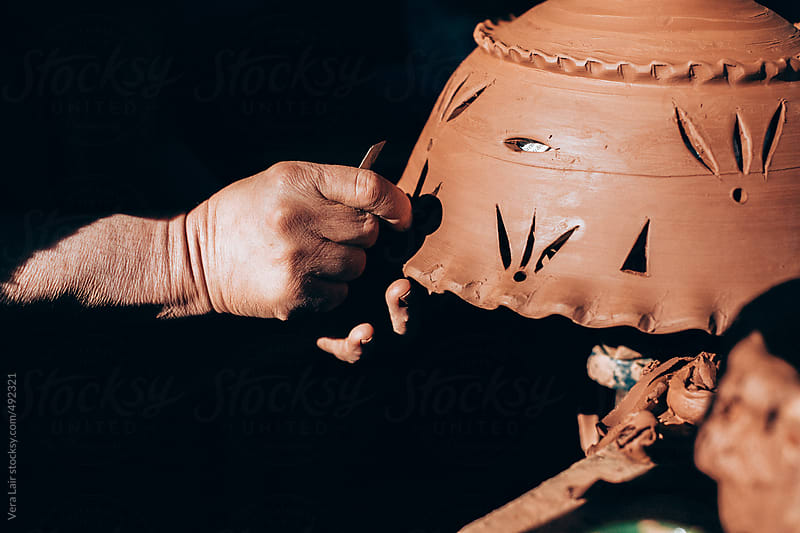 Craftsman hands working with clay by Vera Lair for Stocksy United
