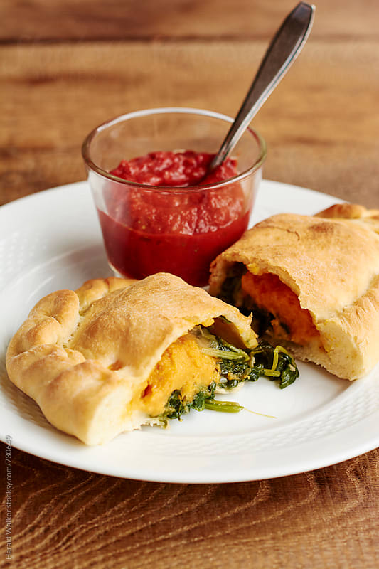 Spinach calzone by Harald Walker for Stocksy United