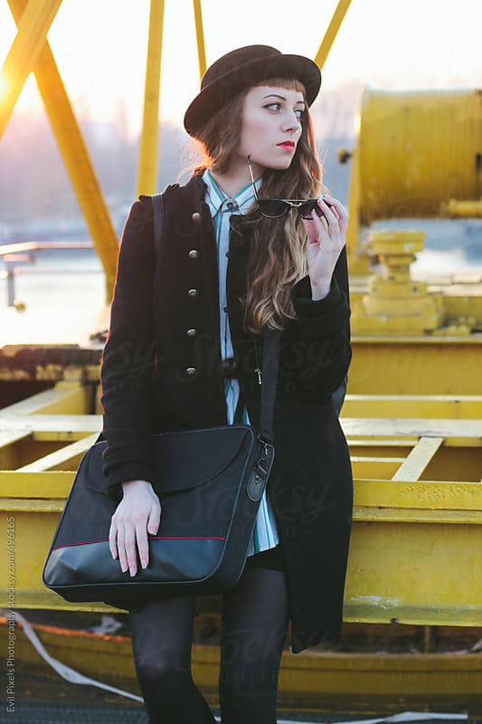Street style of young business woman at the sunset time  by Evil Pixels Photography for Stocksy United
