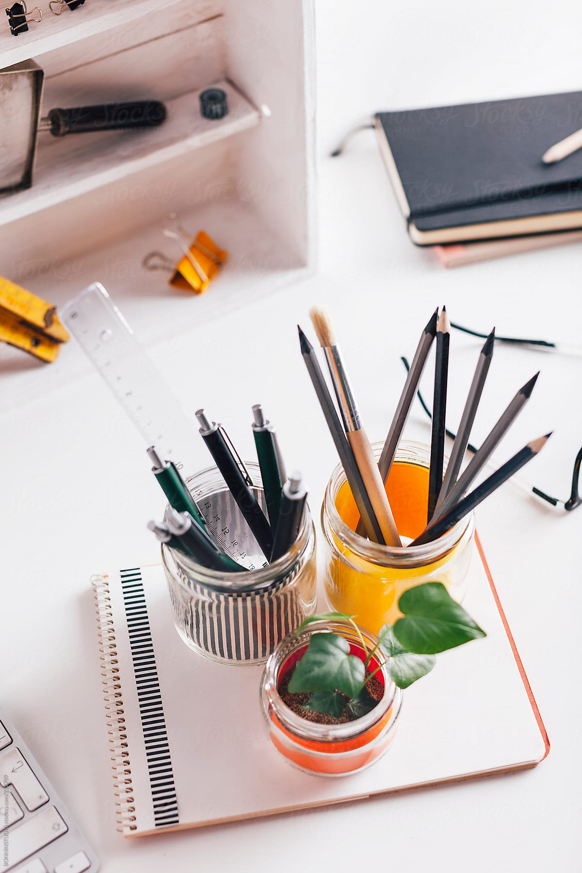 Diy Pencil Holder Jars On A Cute White Home Desk Stocksy United