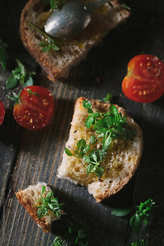 Bread with olive oil and tomatoes by Davide Illini for Stocksy United