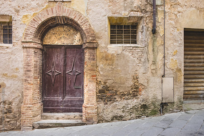 Ruined Alley with Large Closed Door, Old Italian Village by Giorgio Magini for Stocksy United