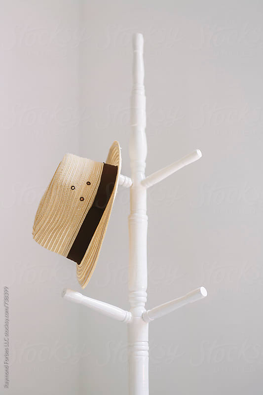 Hat on Coat Rack by Raymond Forbes LLC for Stocksy United