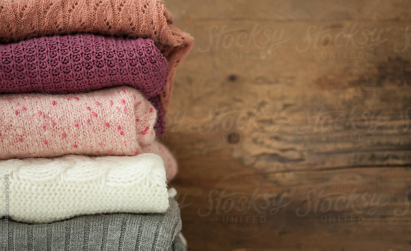 Pile of Sweaters by Mosuno for Stocksy United