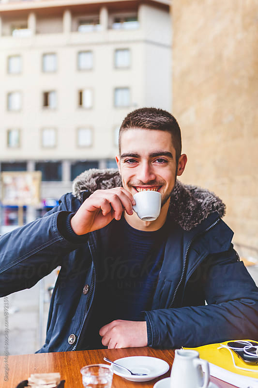 Young Man Having an Italian Espresso during the Cold Season by Giorgio Magini for Stocksy United