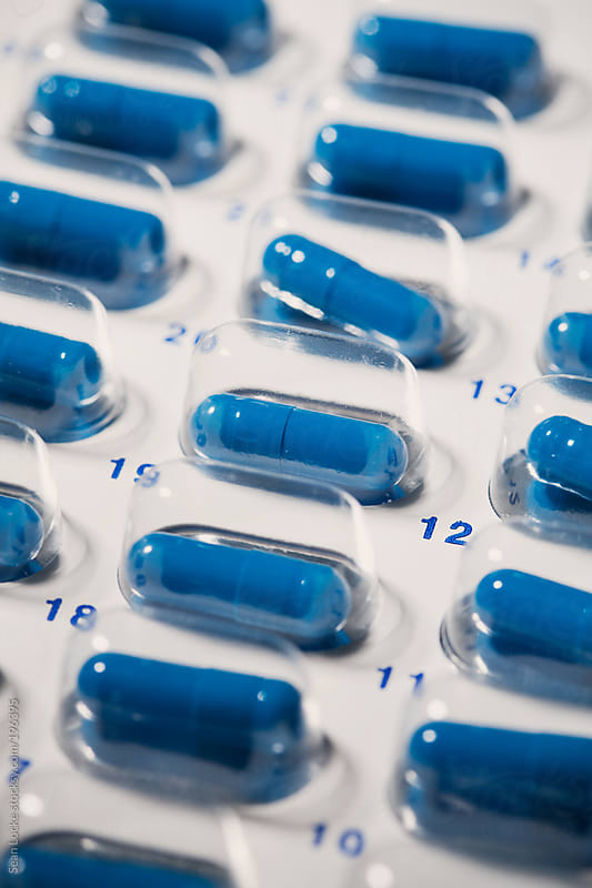 Medicine: Blister Pack Of Blue Capsules by Sean Locke for Stocksy United