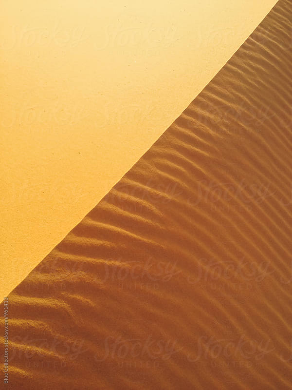 Closeup of sand dune patterns and textures from sand dunes desert, morocco by Jordi Rulló for Stocksy United